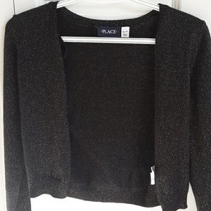A black sparkly pull over